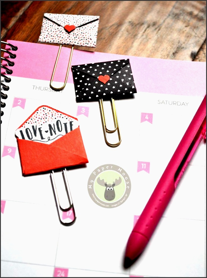 cute mini envelope paper clips make the perfect bookmarks or planner clips using the love
