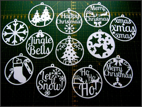 Christmas paper cut templates set of 12 PDF can be used to make decorations and cards for personal use only from ClareWillcocksArt on Etsy Studio