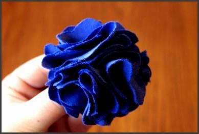 A ruffly blue fabric flower